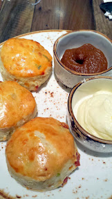 Buttermilk Biscuits with local aged cheddar and smoked bacon served with regular and pumpkin whipped butter, from Della's Kitchen in the Delano, Las Vegas
