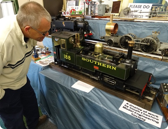 Visitor Mark Ray inspects the display of locomotives and  engines