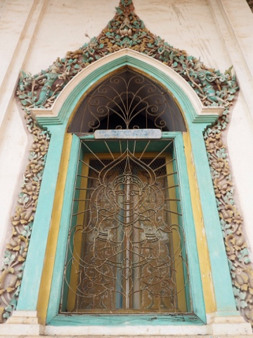 Decorative window on Wat Damrey Sar, Battambang, Cambodia