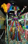 Rainbow Ribbon Dancer on Stilts