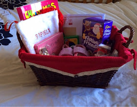 wicker basket with treats for a one year old girl for Christmas