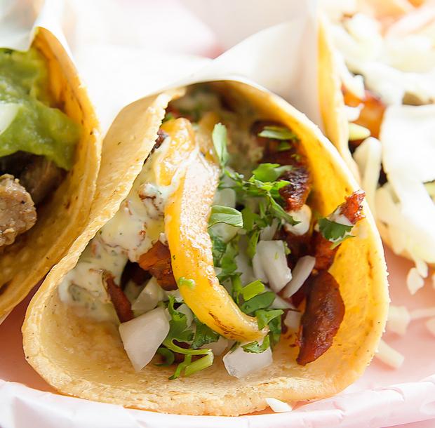 close-up photo of AL PASTOR tacos