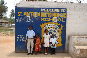 Some kids with the school gate