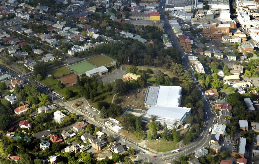 Aerial view to West, Windmill Hill and Launceston Aquatic Centre, High Street runs to left, York Street to the West
