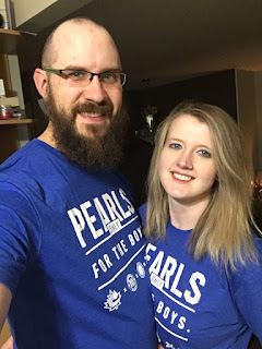 The gentlemen in this picture is a sports lover and thought the Pearls shirts was great idea.  He bought a Pearl shirt for himself and his girl.