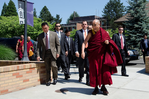 His Holiness the Dalai Lama on the campus of University of Portland for the first day of the Dalai Lama Environmental Summit, Portland, Oregon, U.S., May 9, 2013. Photo by Marc Sakamoto.