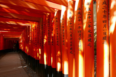 Fushimi Inari Shrine, the famous path of red Torii Gates. The torii gates along the entire trail are donations by individuals and companies, and you will find the donator's name and the date of the donation inscribed on the back of each gate.