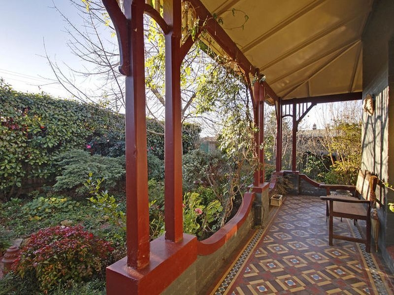 A very fine verandah with original features and tesselated tiling in strict period style