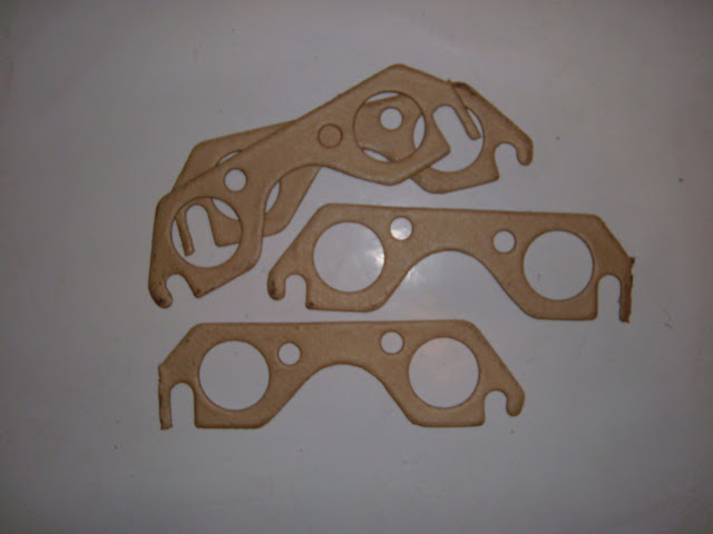 Manifold gaskets. NEVER use these on stock manifolds, Buick never used them, these are for headers only. 14.00