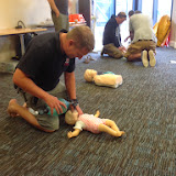Deputy Second Coxswain Dave Riley carrying out assisted breathing using a bag, valve and mask on a baby manikin during a Casualty Care course - hopefully something he won't ever have to do for real - July 2014 Photo: Chris Speers