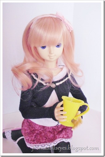 Another ball jointed doll holding one of the tea cups, it looks like a large decorative mug for her size.