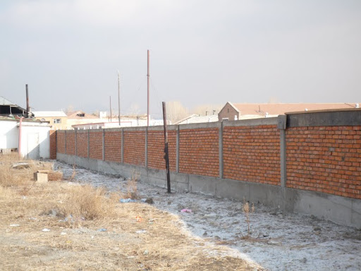 A vital section of a new wall on Dolma Ling Nunnery's eastern boundary providing much needed security for the nuns, Ulaanbaatar, Mongolia, 2012.
