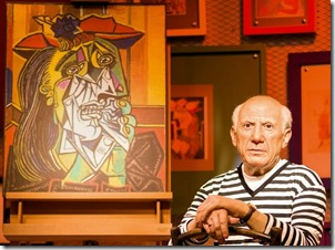 Pablo Picasso with Cubist painting