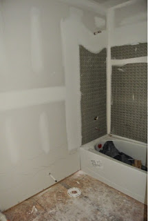 Picture of the hallway full bathroom as viewed through the doorway just after drywall installed