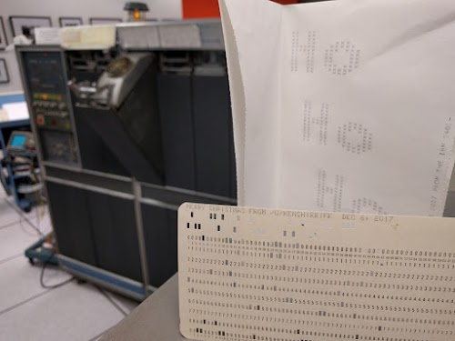 Greeting card created by the IBM 1401 mainframe (background).