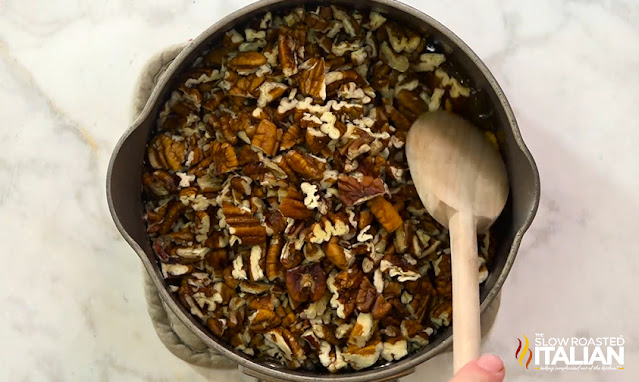 adding pecans to pecan bar filling