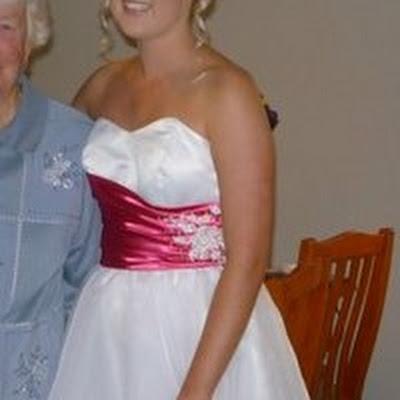 Brittanie - White organza ball dress with pink ruching.