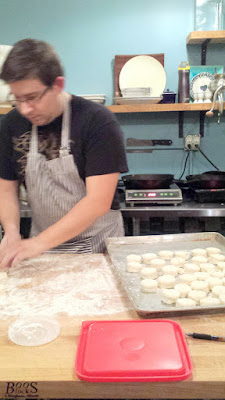 Zach preparing the Angel Biscuits for Mae PDX as the pans get hot behind him for frying the chicken