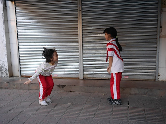 two girls playing a game in Shaoguan, Guangdong