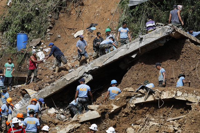 Rescuers search for landslide victims in Itogon in the Philippines on Monday, 17 September 2018. Photo: Francis R. Malasig / EPA