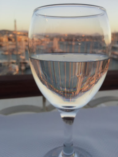 Marina through my water glass, sunset in Kusadasi