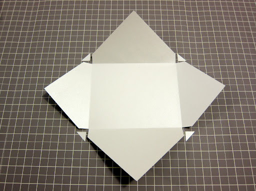 Then, just by cutting out the little triangles, you can begin to see the envelope really taking shape.