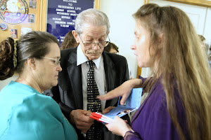 Susan handing out brochures for Ecuador Missions.