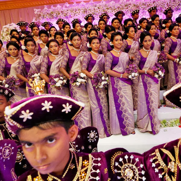Bridesmaids and page boys stand on a platform during the wedding ceremony of Sri Lankan couple Nalin and Nisansala as they attempt to set a Guinness record for a wedding with the most number of bridesmaids for a bride in Negombo, on the outskirts of Colombo, Sri Lanka, Friday, Nov. 8, 2013.