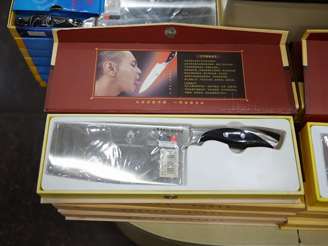 knife package with image of a man's tongue nearly touching the blade of a knife