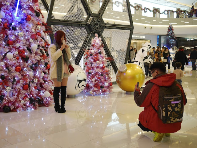 posing for a photo in front of a Star Wars Christmas tree at the IAPM shopping center in Shanghai