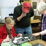 (R) Helen Jane Peters shares photos with guests who identify familiar faces, February 2015 Open House.