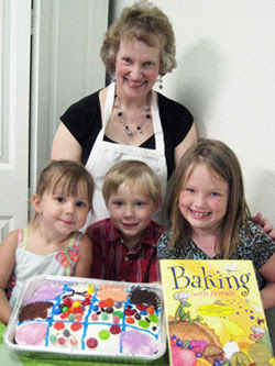 Charlene with kids and Baking with Friends cookbook