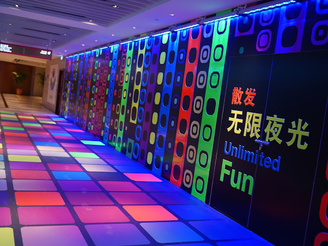 "colorful hallway with the words ""Unlimited Fun"""