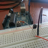 Close-up of the resistor and transistor on the breadboard prototype. Arduino Uno in the background.