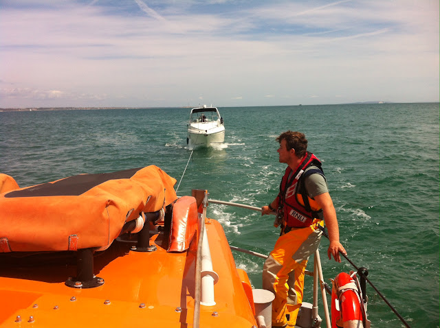 Poole's ALB tows in a cabin cruiser following an on-board fire - 18 July 2015.  Photo credit: Dave Riley