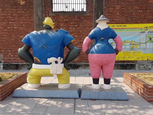 Man and woman art structure at Pier-2 Art Center, Kaohsiung