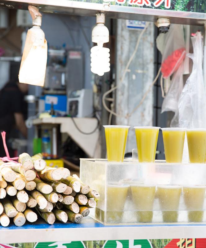 photo of a vendor selling sugar cane juice
