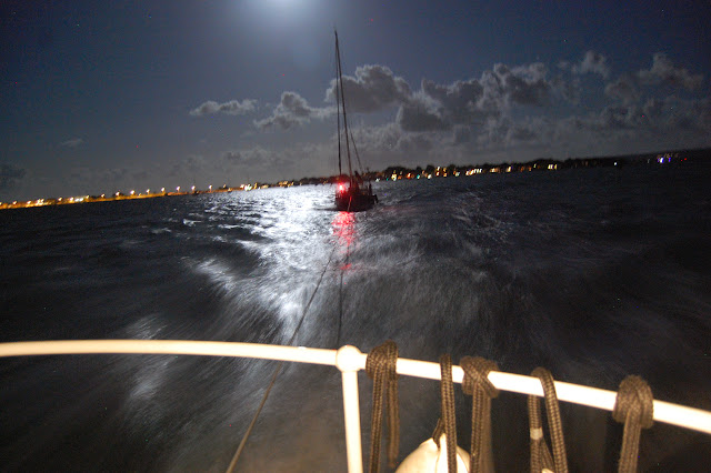 Poole all-weather lifeboat towing the yacht inside Poole Harbour. Calm seas after an eventful evening in near gale force winds and confused seas in Poole Bay and a 6-hour call out. 10 August 2014 Photo: RNLI Poole/Dave Riley