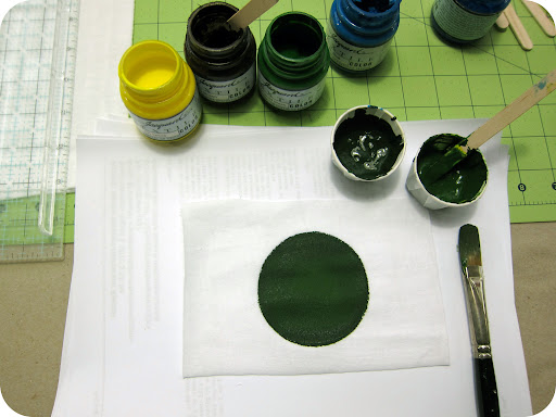 Paint circles using fabric paint. I made green irises but mixed in a bit of blue and brown as well.