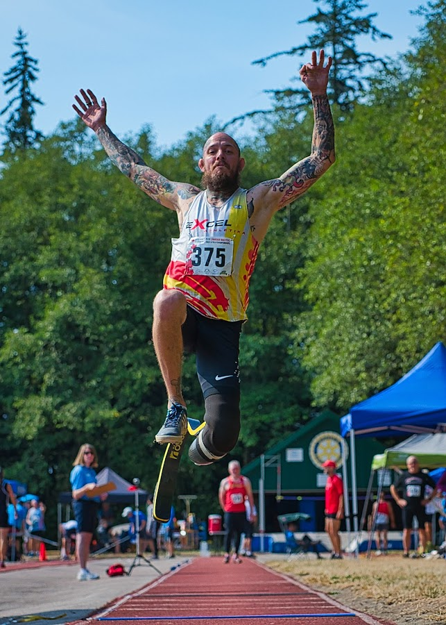 Rising To The Challenge by Garry Dosa - Sports & Fitness Other Sports ( tattoo, airborne, sports, long jump, outdoors, athlete, games, athletics, people )