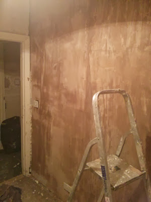Once we'd boarded out the dressing room, time to plaster the new wall. Yeah, it's as good as I can do I'm afraid (now hidden behind wardrobes)