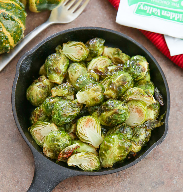 overhead photo of ranch roasted brussels sprouts in a skillet
