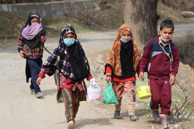 Children's walking towrds their community school to attend their classes at South Kashmir's Pulwama village