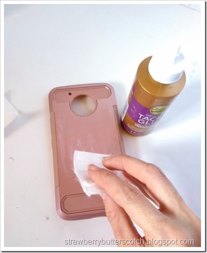 Spreading glue onto the phone case.