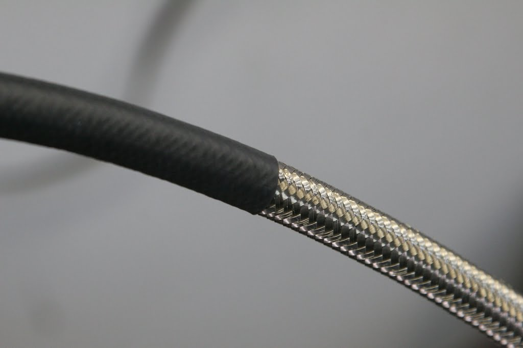 heat shrink tubing prevents it from abrating against anything - this hose will cut through other metal over time