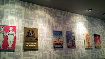 Soviet Union era posters along the back wall of Portland Penny Diner during the DaNet popup