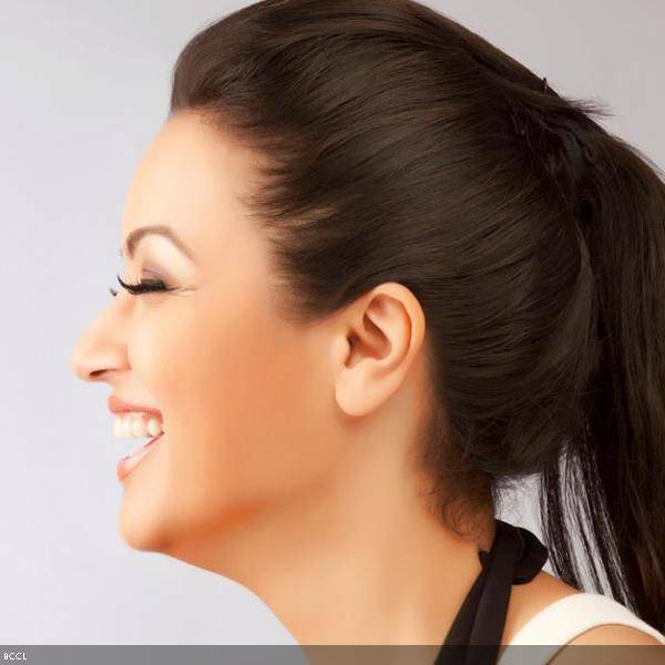 Maryam Zakaria flashes a smile during a photoshoot.