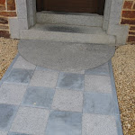 Entrance with honed and bush hammered tiles