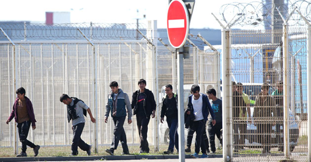 Migrants walk through the harbour of Calais, France, 7 September 2016. Photo: Reuters