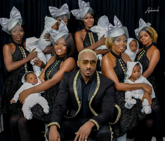 Nigerian socialite and businessman, Pretty Mike with his six wives trending photo